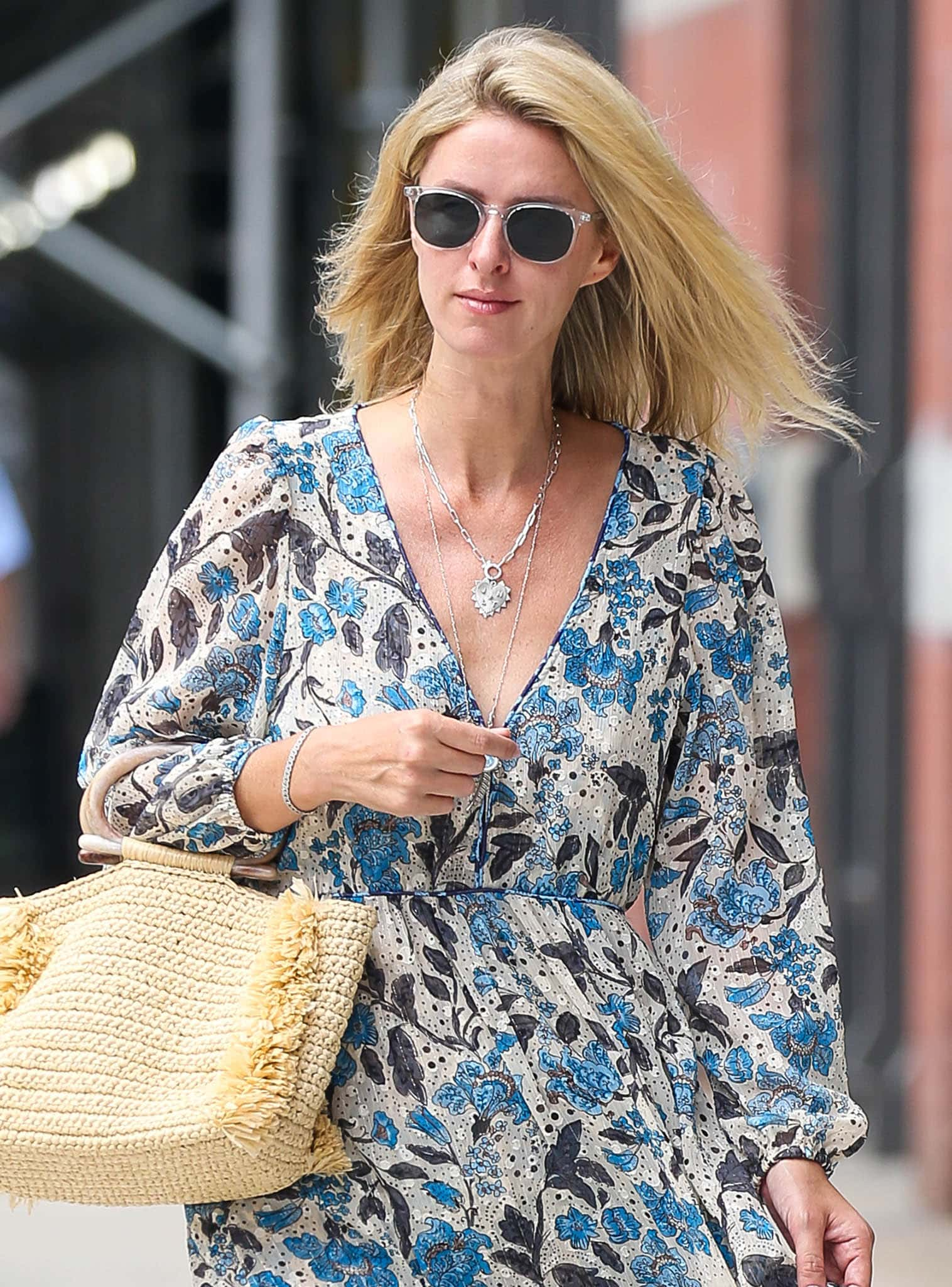 Nicky Hilton wears barely-there makeup with a side-swept hairstyle