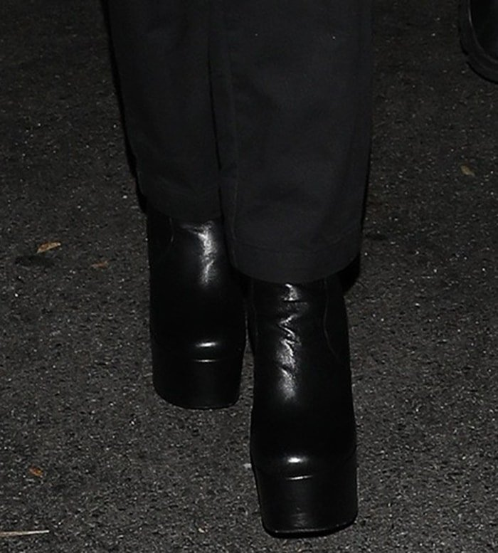 Nicola Peltz completes her all-black look with Yves Saint Laurent Billy platform boots