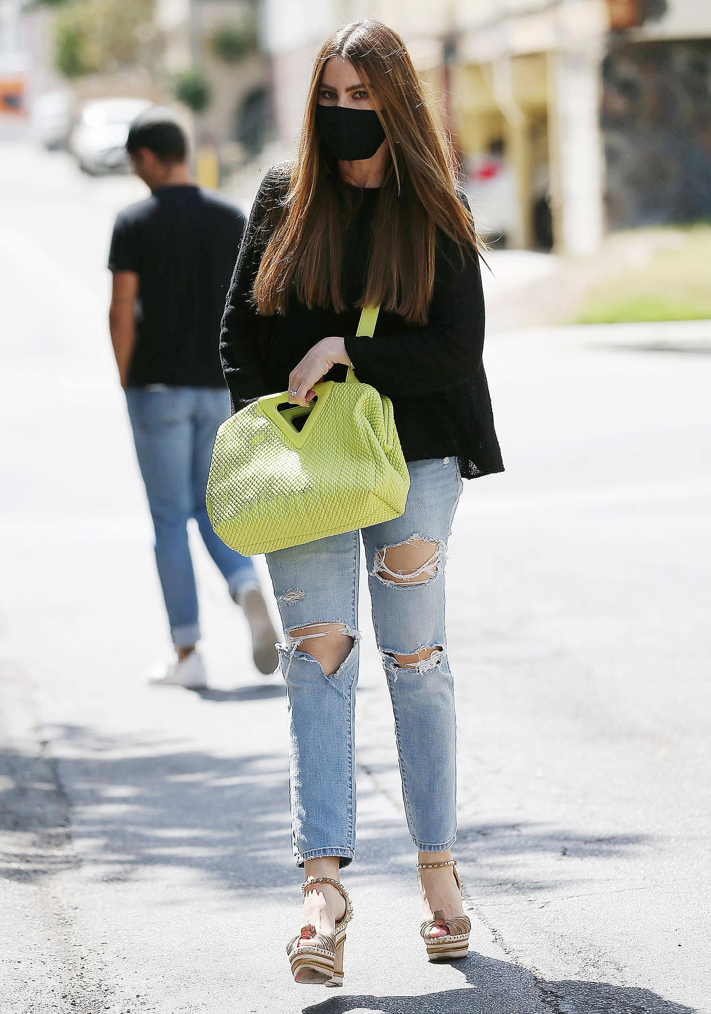 Sofia Vergara is seen house hunting in Los Angeles in a black knit top with ripped jeans on July 22, 2021
