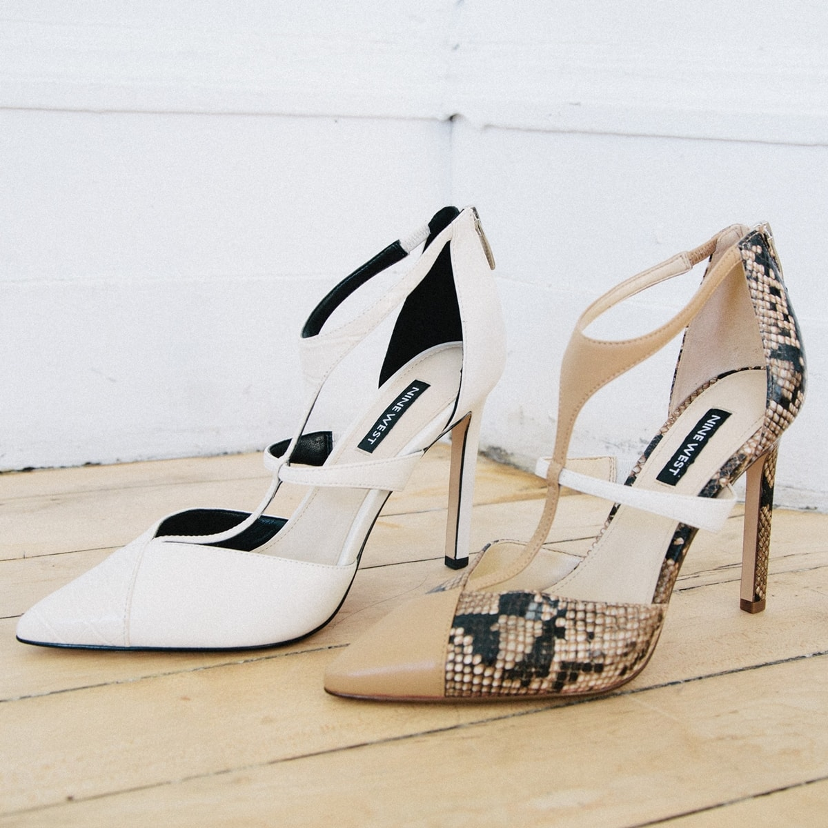 Nine West's chic cream and natural snake Tstrap dress t-strap pumps feature a high heel and pointy toe