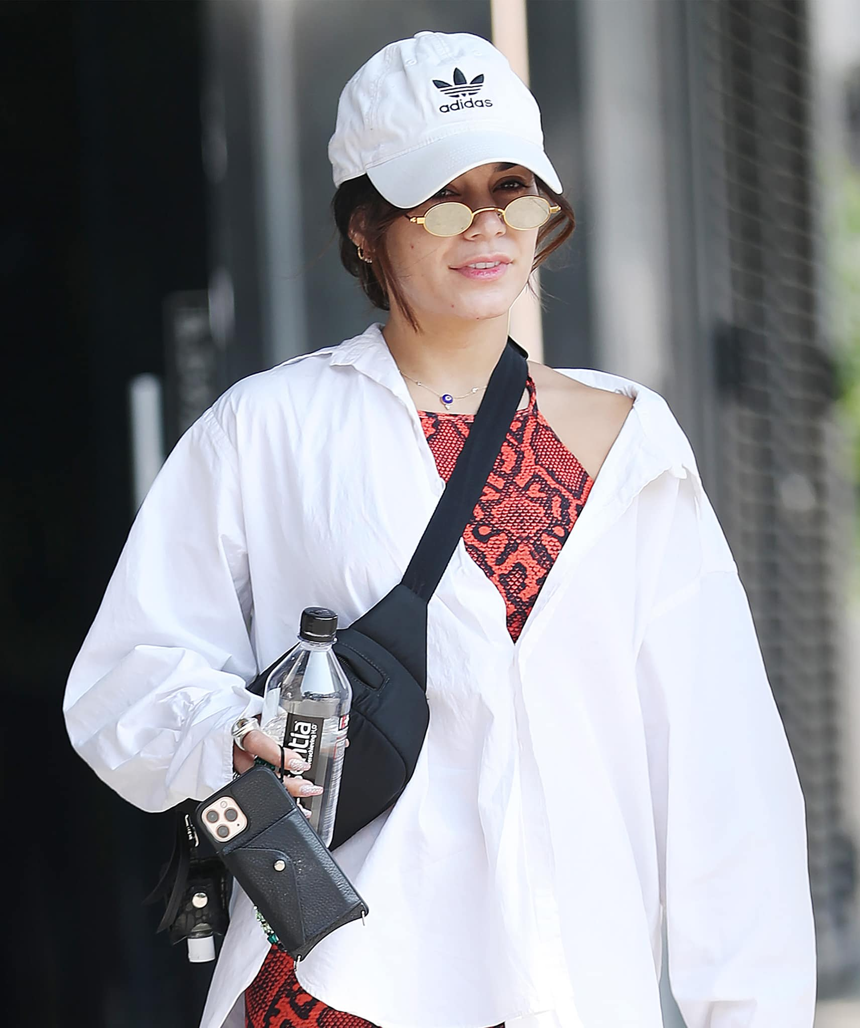 Vanessa Hudgens keeps a low-key look with an Adidas cap and Roberi & Fraud sunglasses