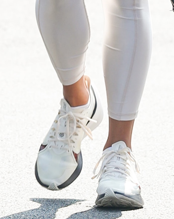 Vanessa Hudgens completes her monochromatic athletic outfit with Nike Zoom Gravity shoes
