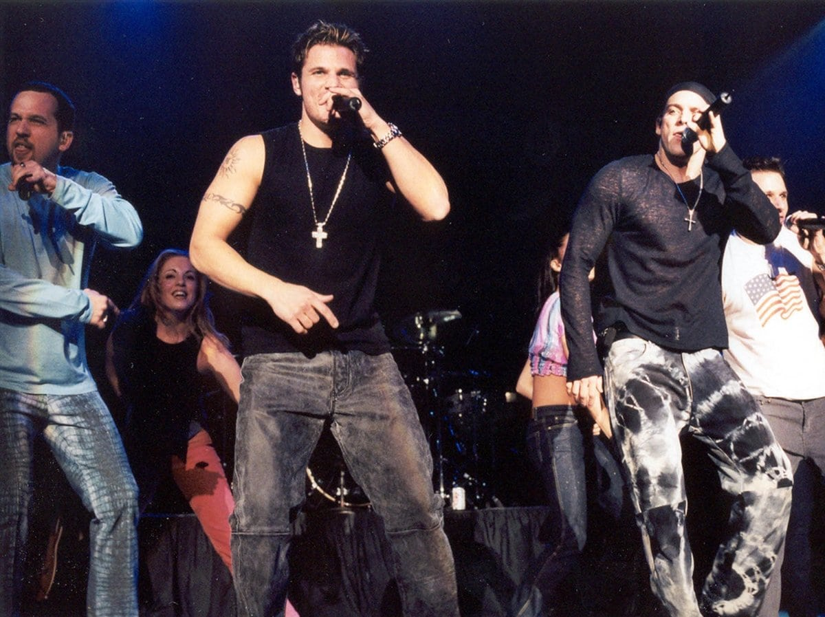 American pop and R&B vocal group 98° consists of Jeff Timmons, brothers Nick and Drew Lachey, and Justin Jeffre