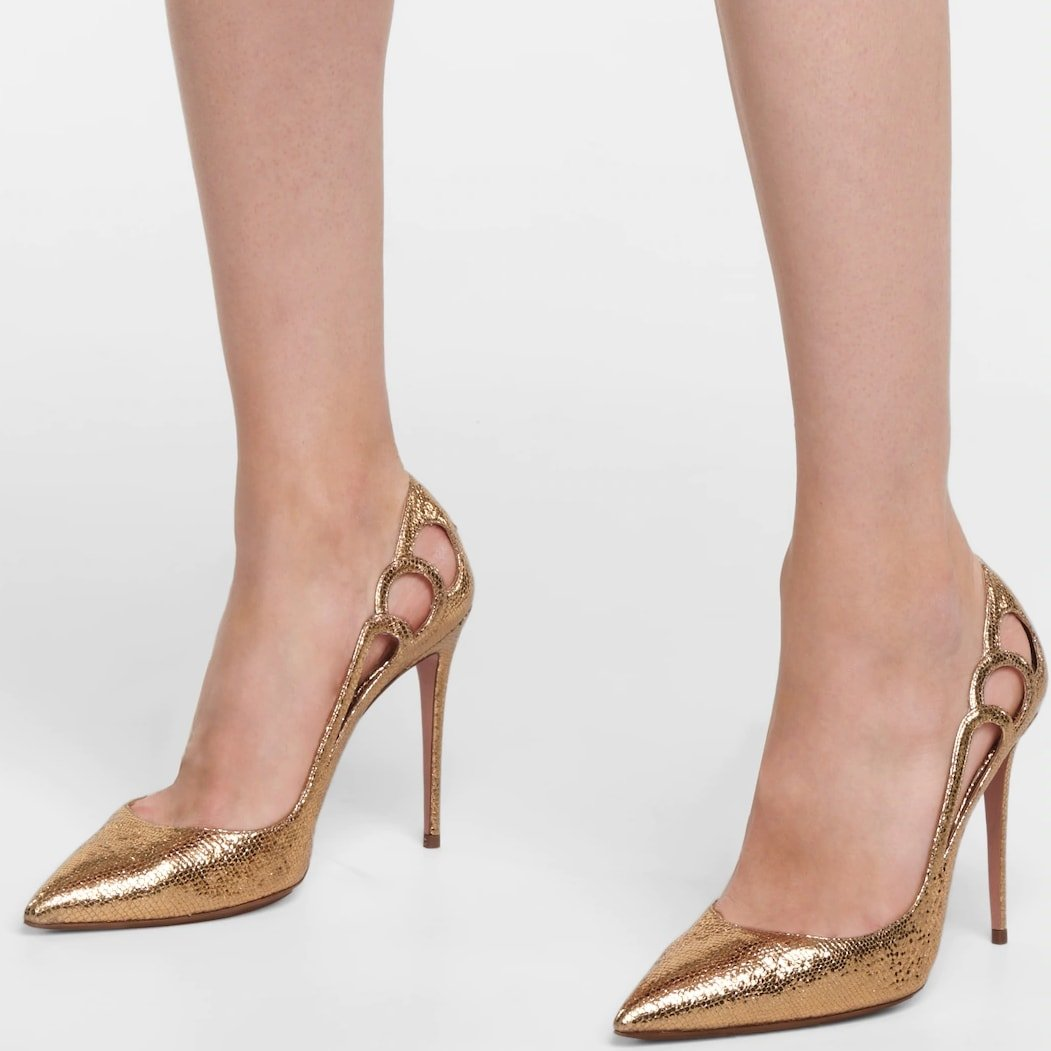 Aquazzura's Fenix pump features side cutouts for a hint of skin and is balanced on a pin-thin heel