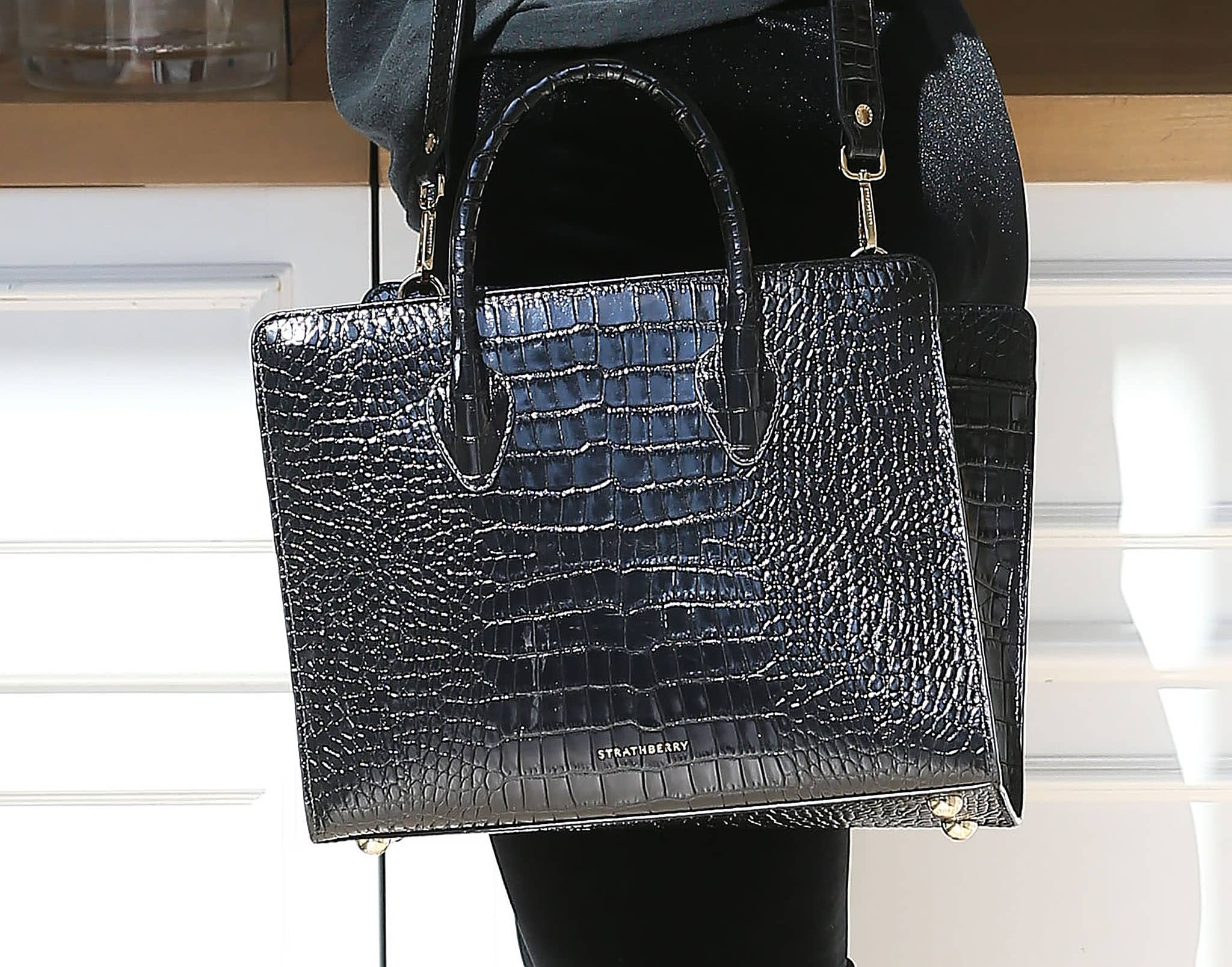 Addison Rae carries the Midi black croc-embossed leather tote from royal-approved bag label Strathberry