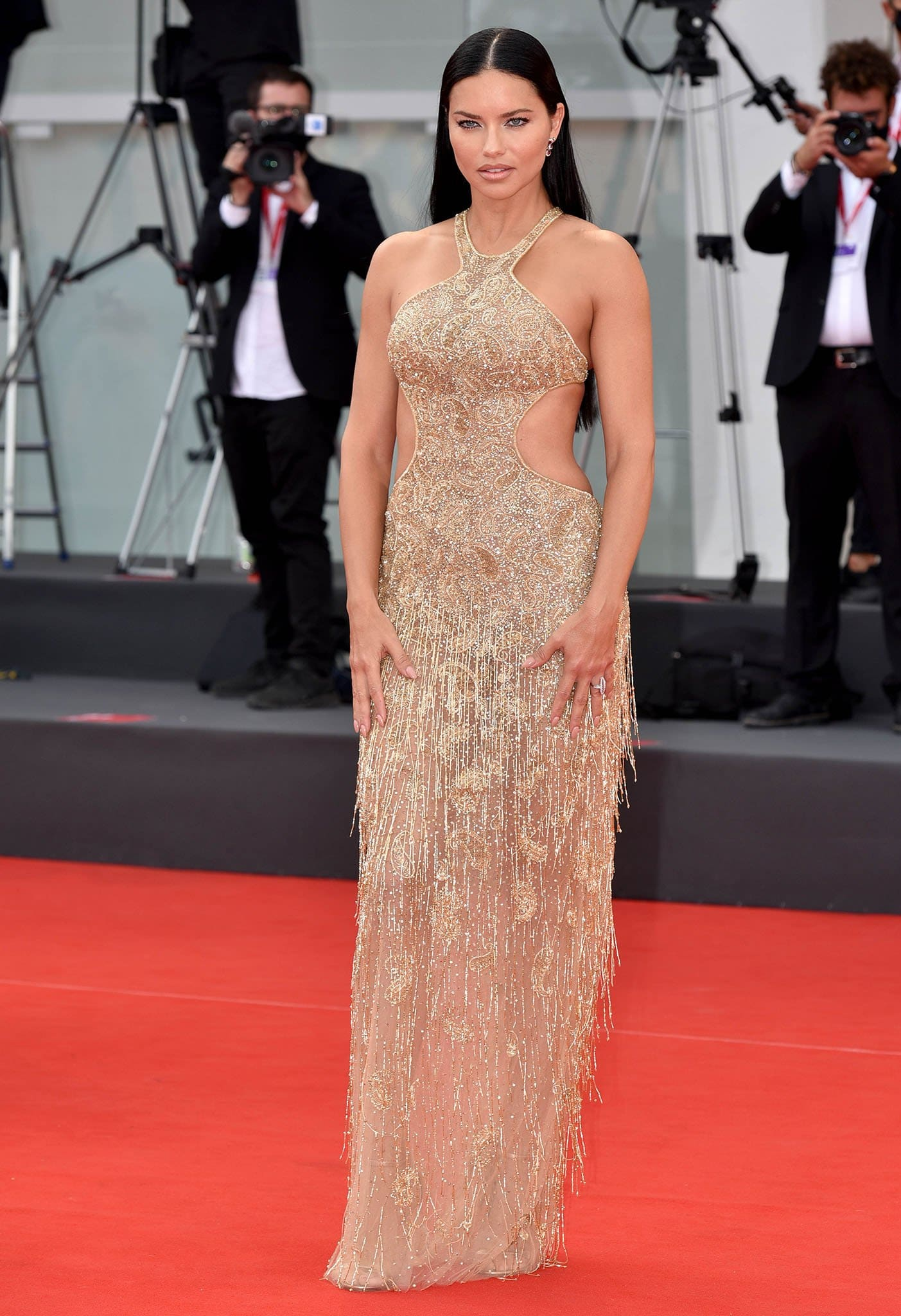 """Adriana Lima in a gold glass-embellished dress at the premiere of """"Dune"""""""