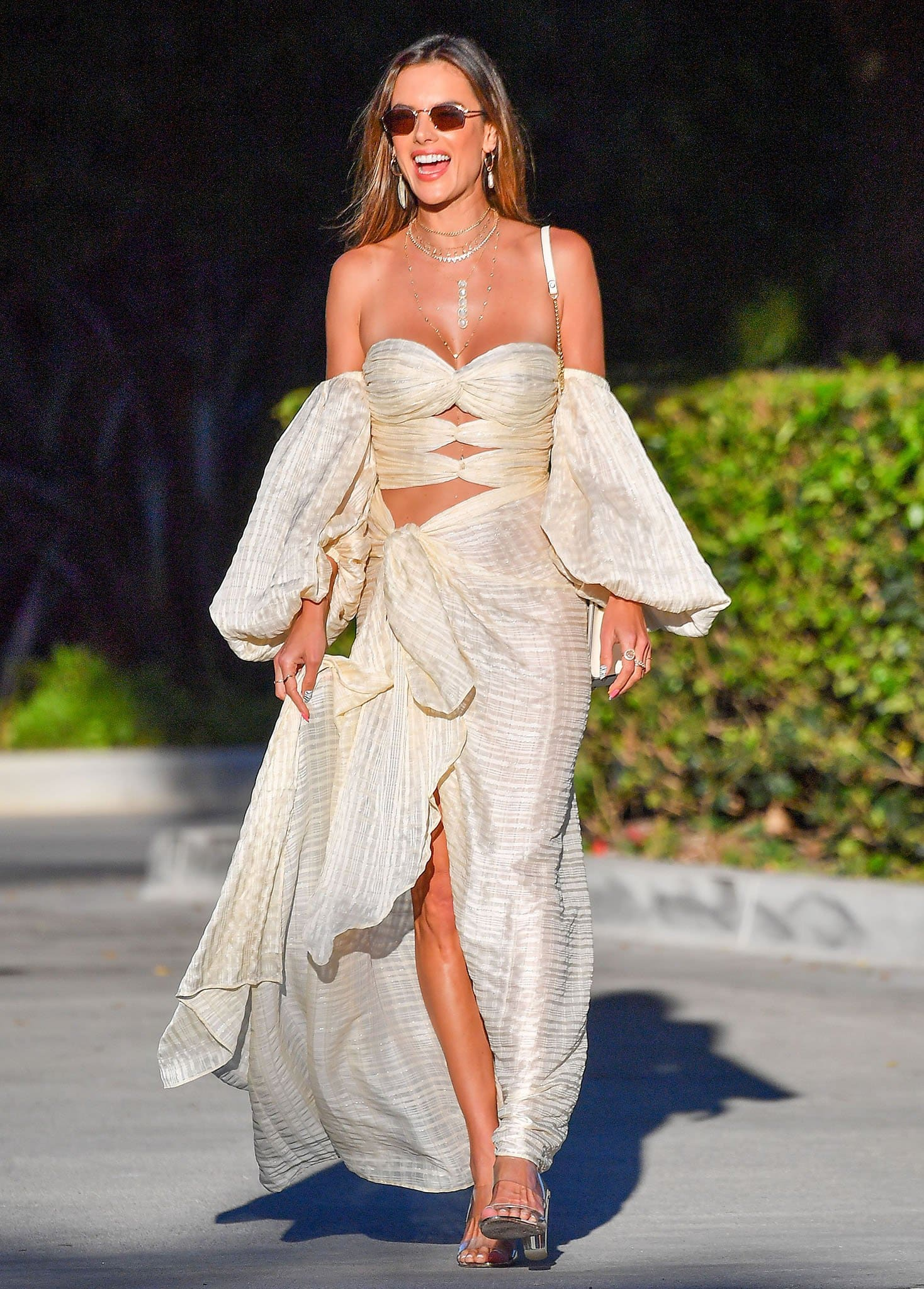 Alessandra Ambrosio shows some flesh in Bronx and Banco semi-sheer gauze crop top and matching maxi skirt