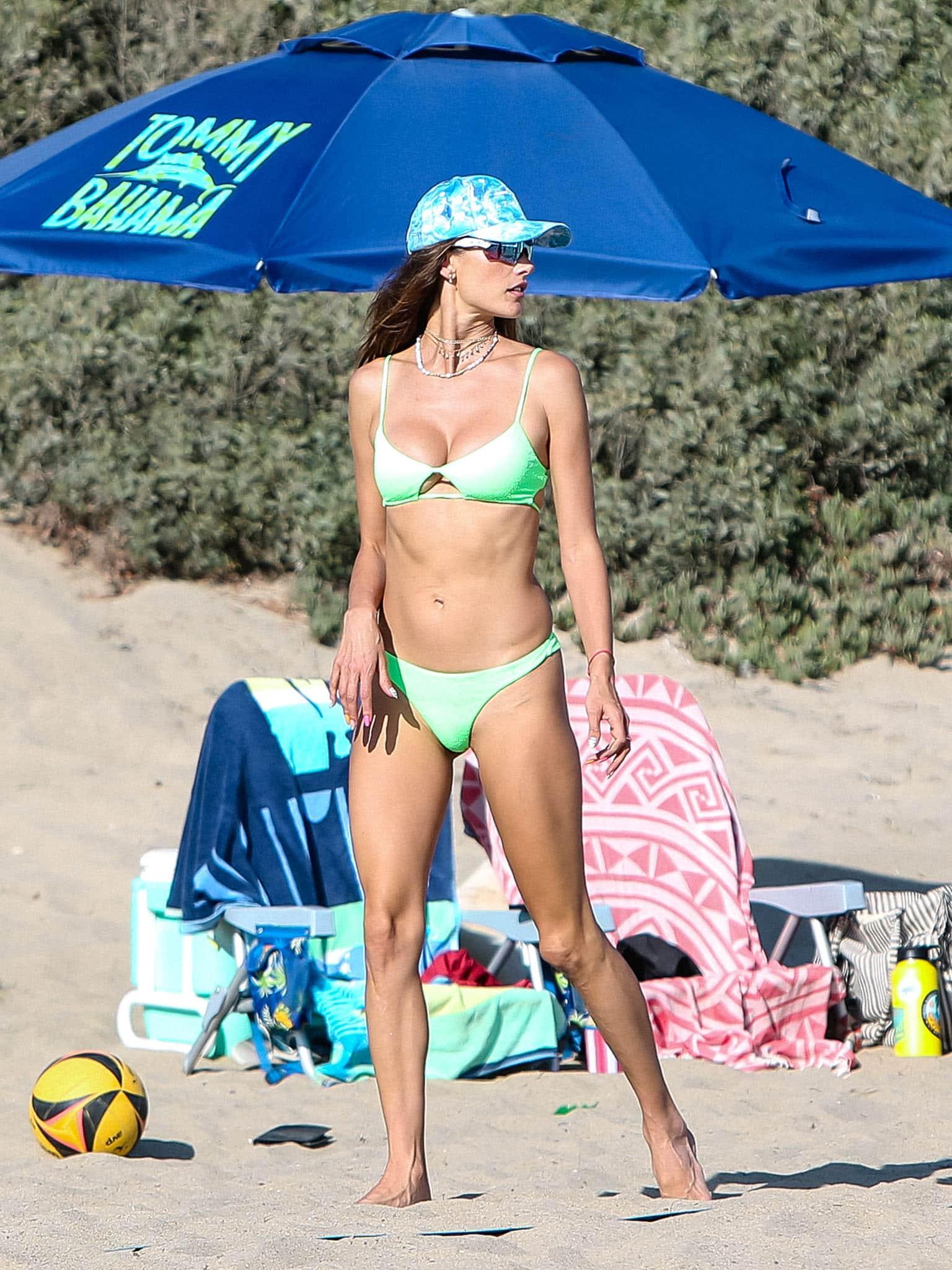 Alessandra Ambrosio flaunts her bikini body in Vix neon green bikini