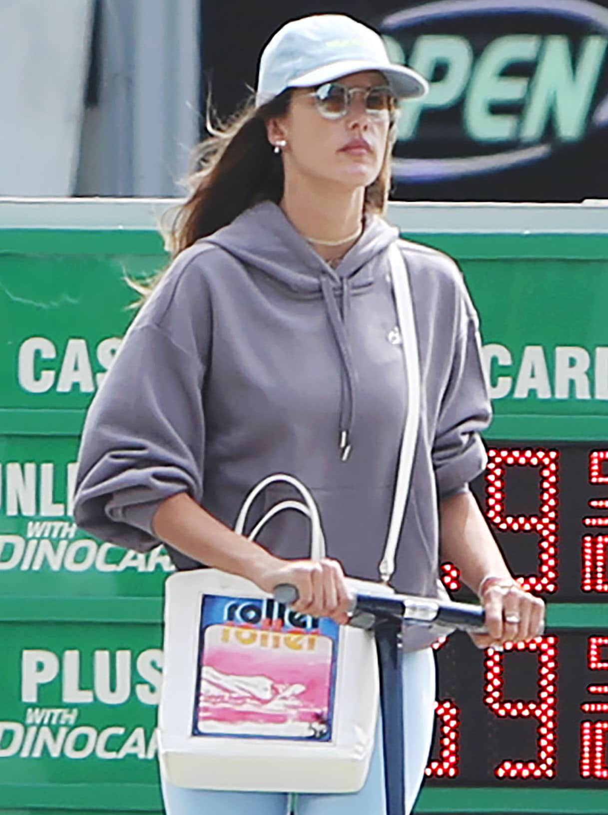 Alessandra Ambrosio pairs her sporty outfit with a Zimmermann tote and Quay Farrah sunglasses