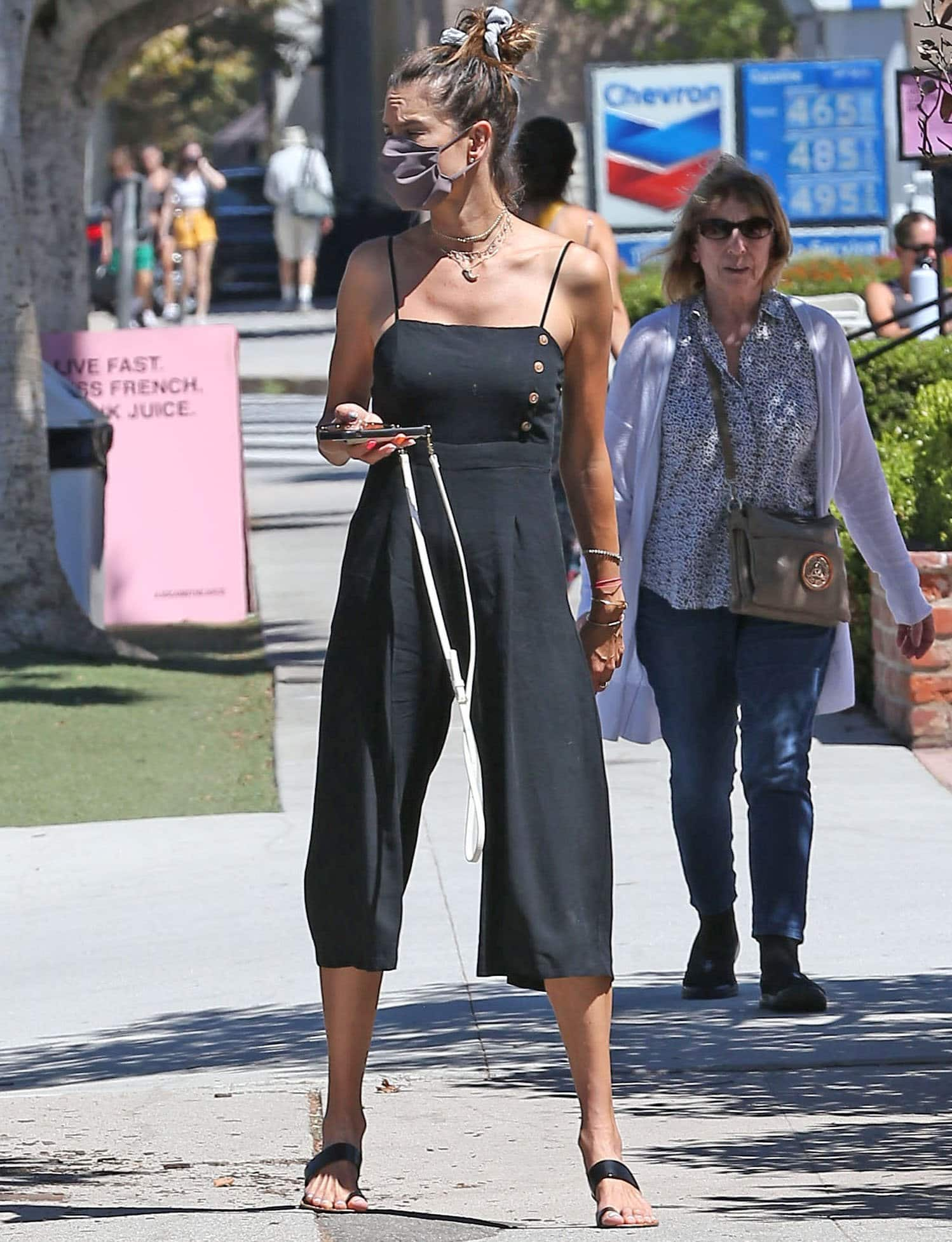 Alessandra Ambrosio looks chic in a black culotte jumpsuit that highlights her model figure
