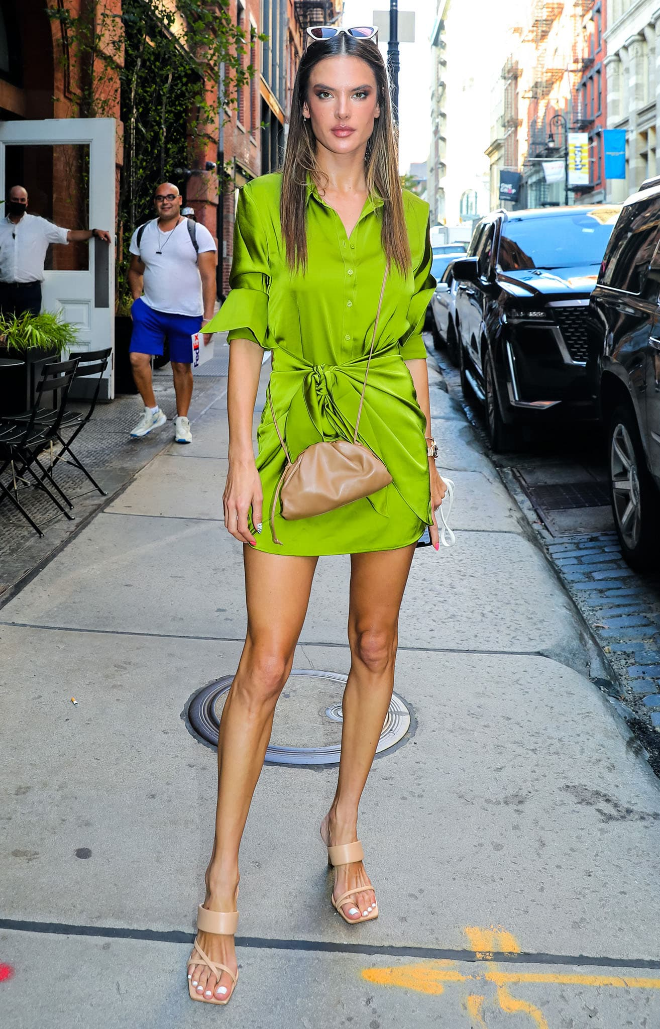 Alessandra Ambrosio showcases her long legs in a green silk shirt dress during New York Fashion Week on September 8, 2021