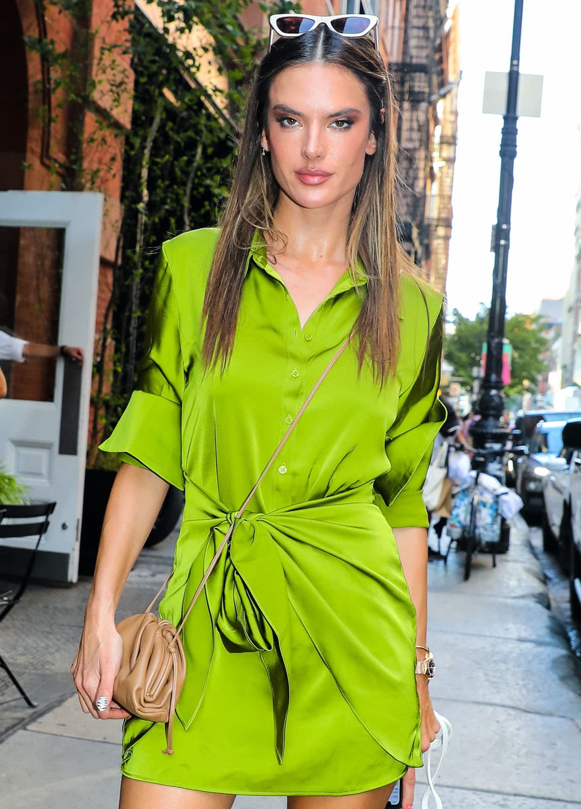 Alessandra Ambrosio wears sleek straight damp hair and smokey eye-makeup