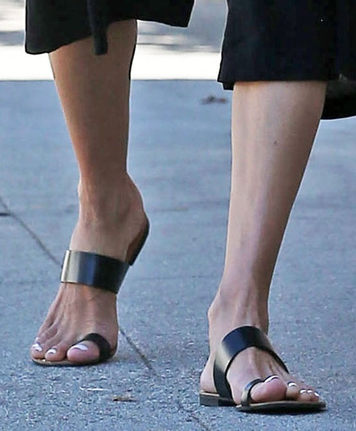 Alessandra Ambrosio completes a chic and comfy look with toe-ring flat sandals