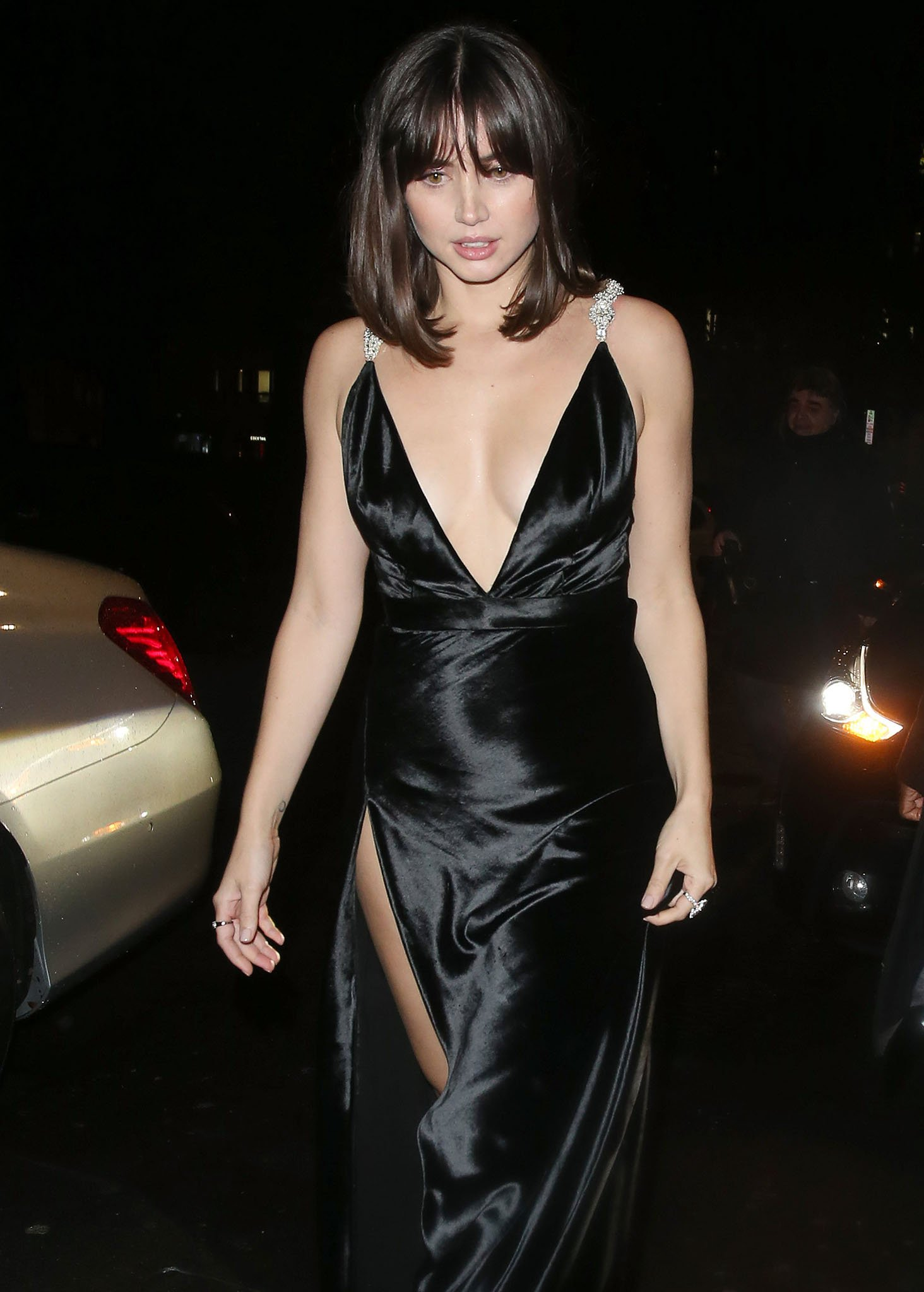 Inspired by Michelle Pfeiffer's Scarface look, Ana de Armas' makeup features soft smokey eyes and nude lips
