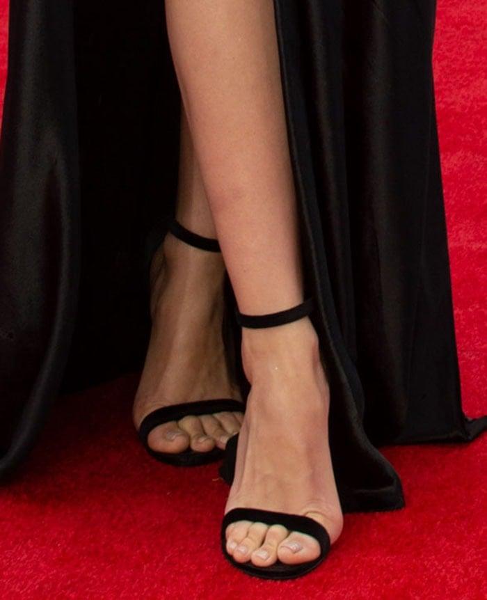 Ana de Armas shows off her feet in Louis Vuitton black velvet heels