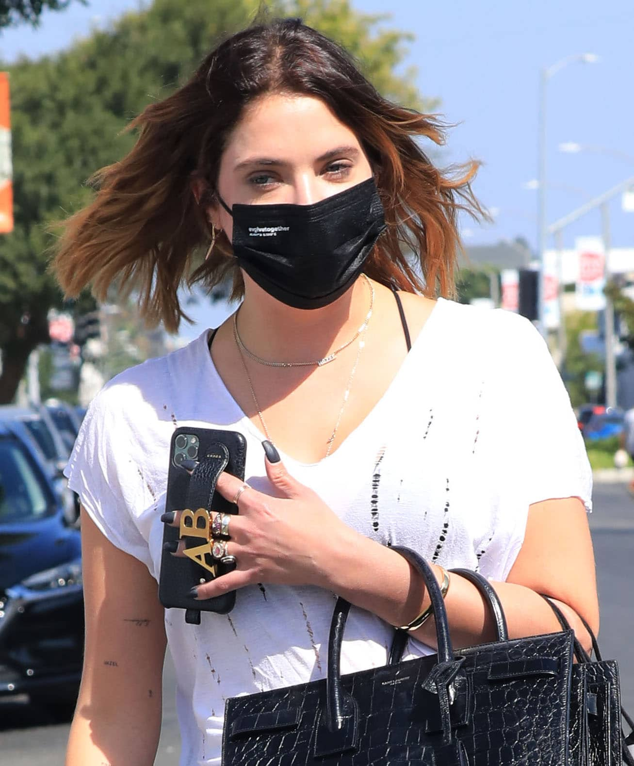 Ashley Benson wears barely-there makeup look with a black EvolveTogether face mask for protection