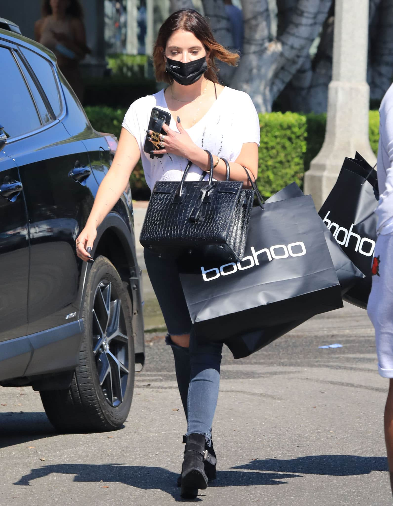Ashley Benson channels biker chick in a distressed white tee with Rag & Bone black skinny jeans
