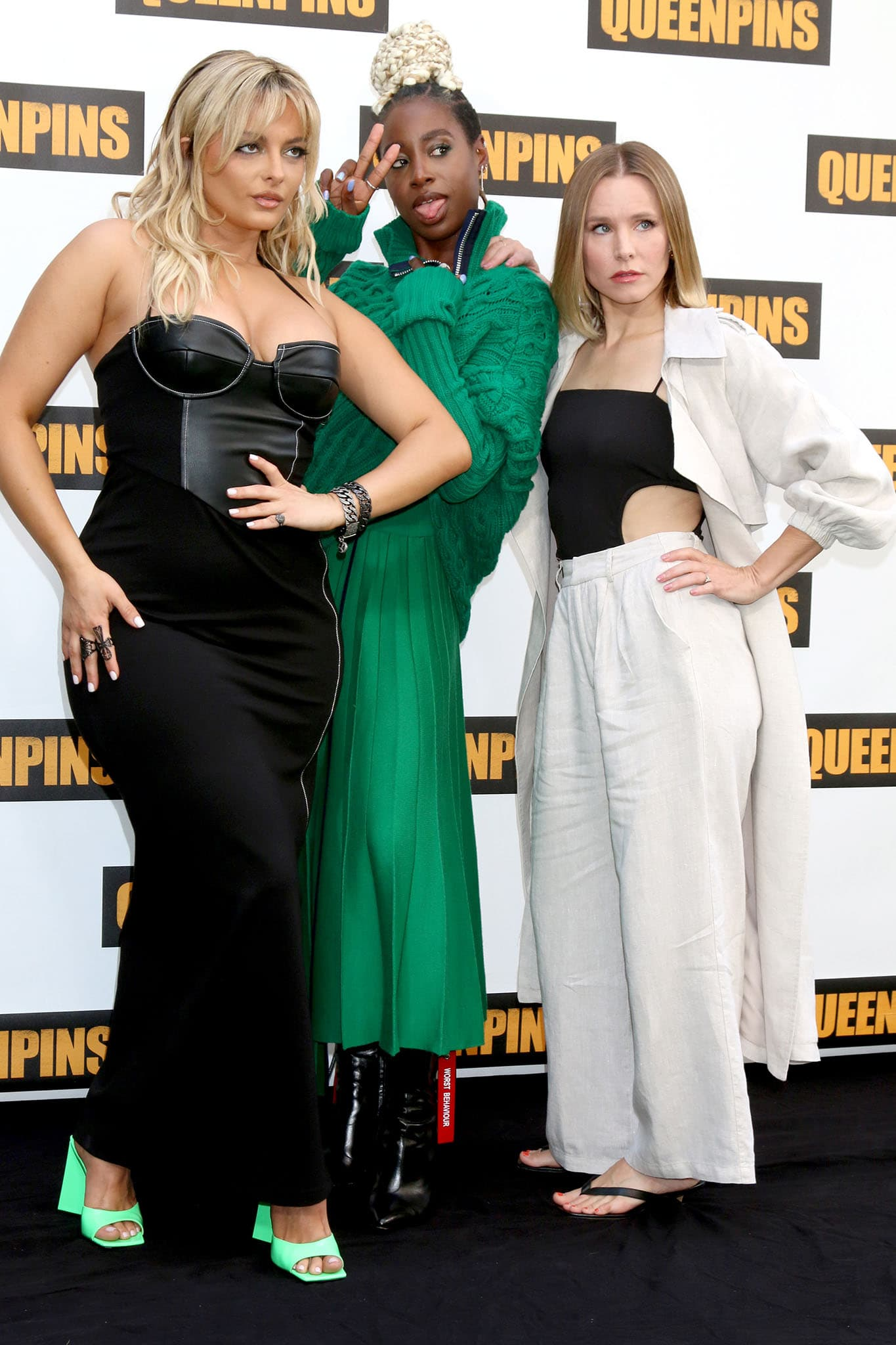 Bebe Rexha, Kirby Howell-Baptiste, and Kristen Bell pose for photos at the Queenpins photocell