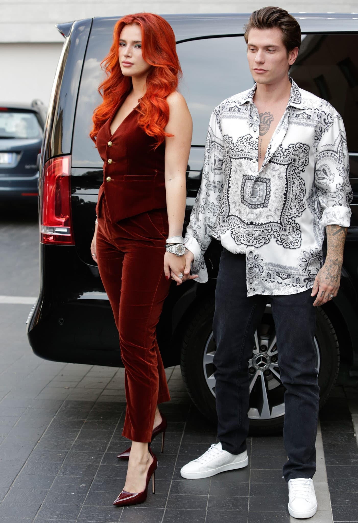 Bella Thorne and fiancé Benjamin Mascolo arrive at the Etro runway show during Milan Fashion Week