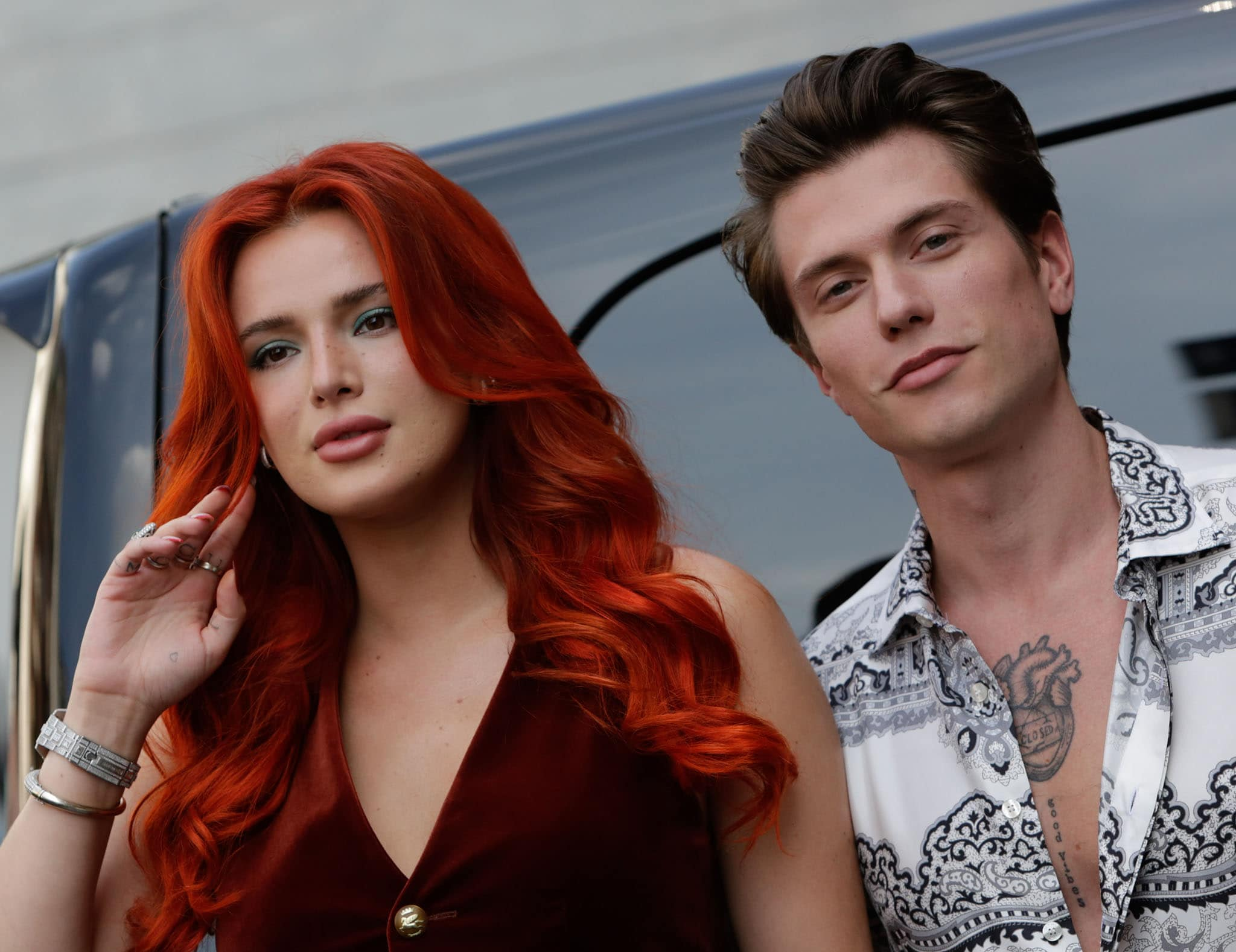 Bella Thorne wears her red hair in soft waves and accentuates her eyes with cyan eyeshadow