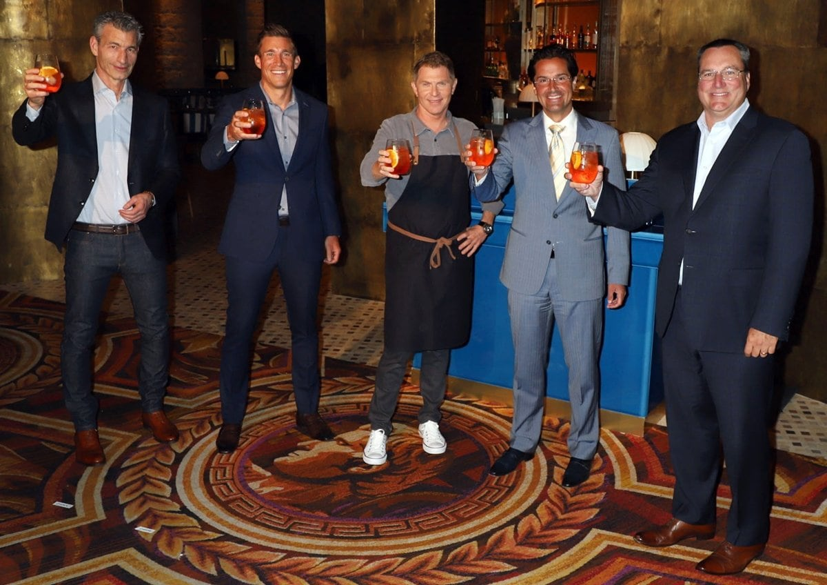Entrepreneur Laurence Kretchmer, Caesars Entertainment Chief Operating Officer Anthony Carano, television personality and chef Bobby Flay, Caesars Palace General Manager Sean McBurney, and Caesars Entertainment Chief Executive Officer Tom Reeg attend the grand opening of Amalfi by Bobby Flay