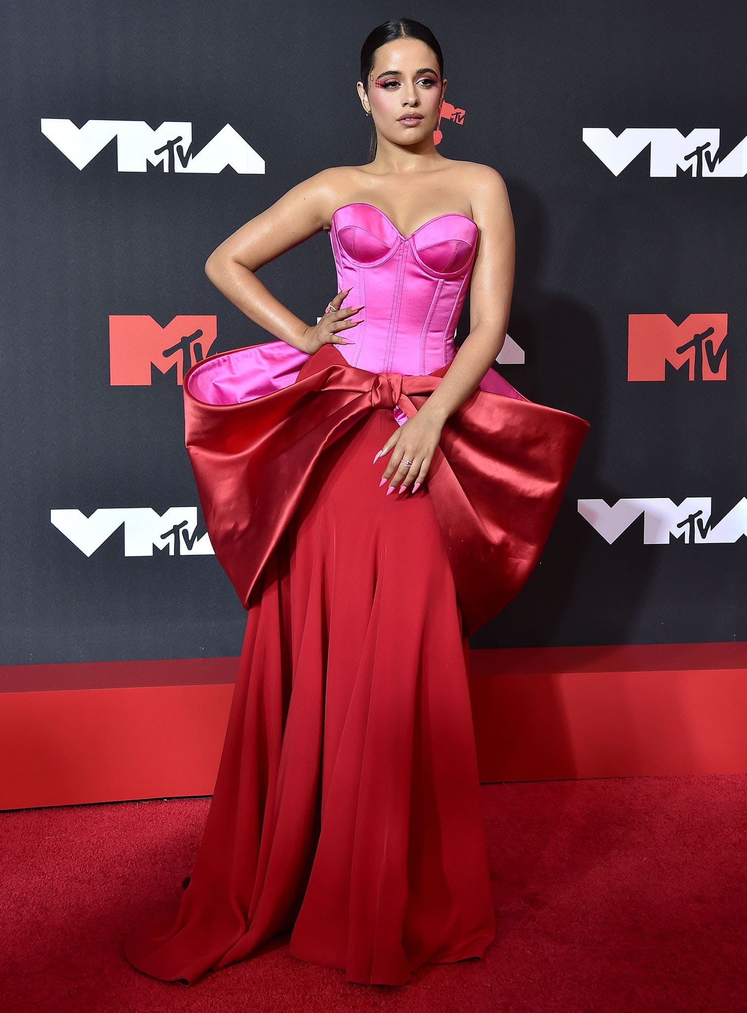 Camila Cabello attends the 2021 MTV VMAs in Alexis Mabille Fall 2021 pink and red color-block gown on September 12, 2021