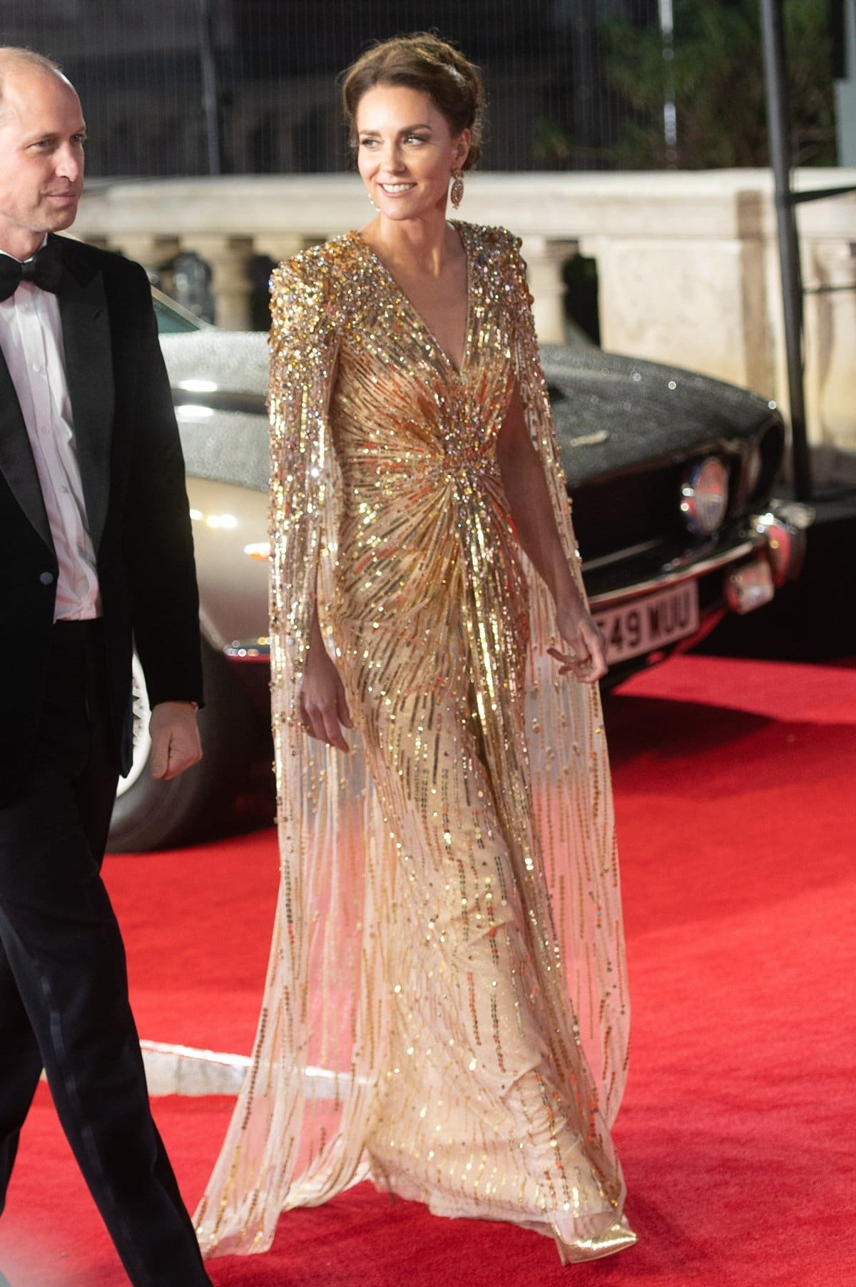 Kate Middleton arriving in gold Aquazzura Fenix 105mm pointed pumps