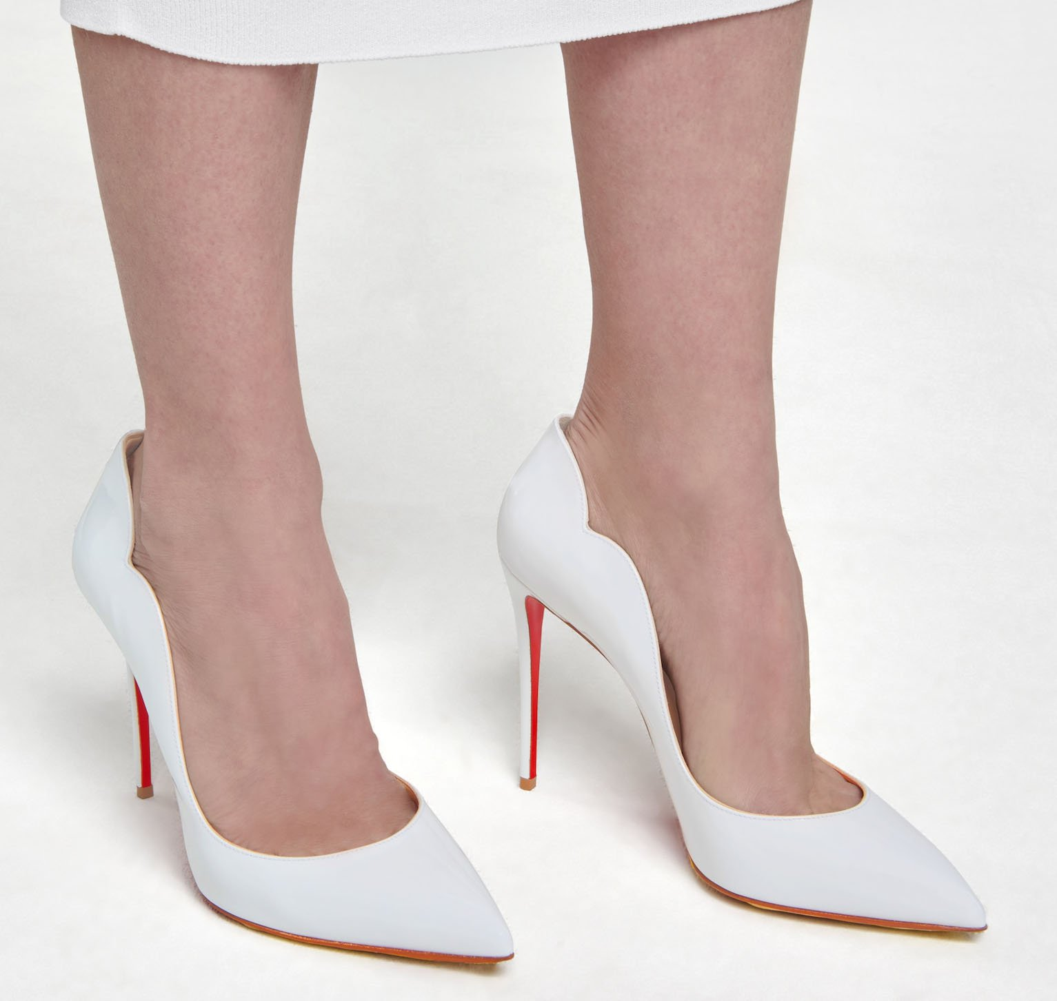 Christian Louboutin's Hot Chick is a modern take take on the classic pump silhouette with its notched scalloped collar