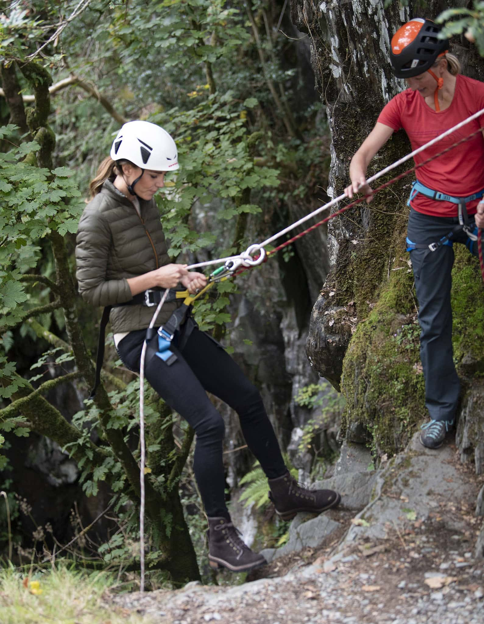 Kate Middleton tries out abseiling during her visit at the reopening of the Royal Air Force Windermere Adventure Training Centre