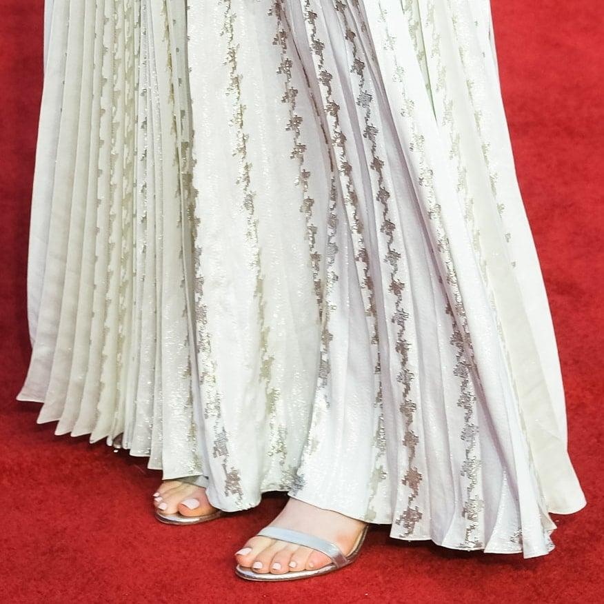 Emma Raducanu shows off her feet in silver Dior sandals