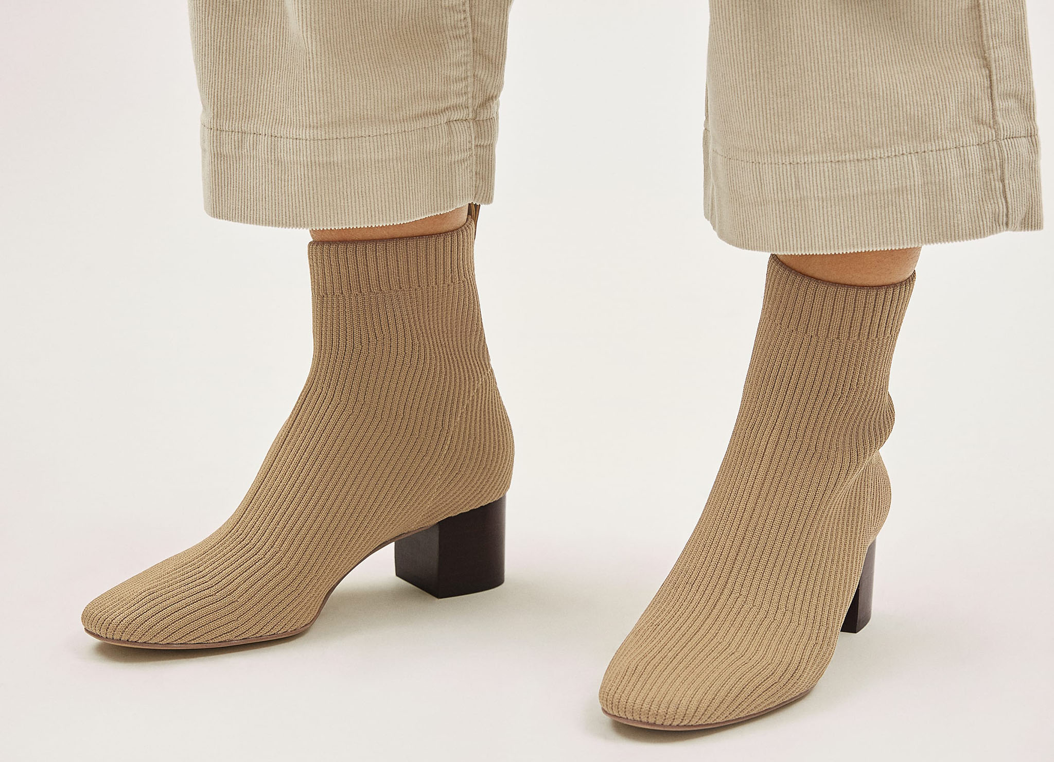 A flattering pair of boots made from textured re-knit fabric with chic rib detailing and comfy heels