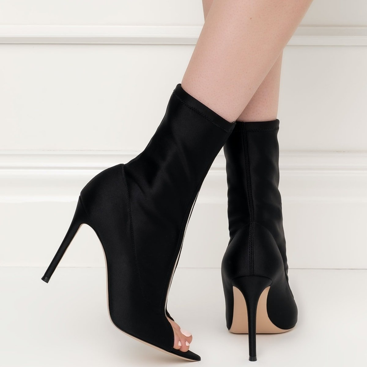 Gianvito Rossi's Hiroko peep-toe booties are defined by the clear strip that runs down the shoe