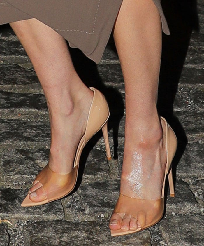 Gigi Hadid completes her evening look by showing off her feet in Gianvito Rossi Bree PVC pumps
