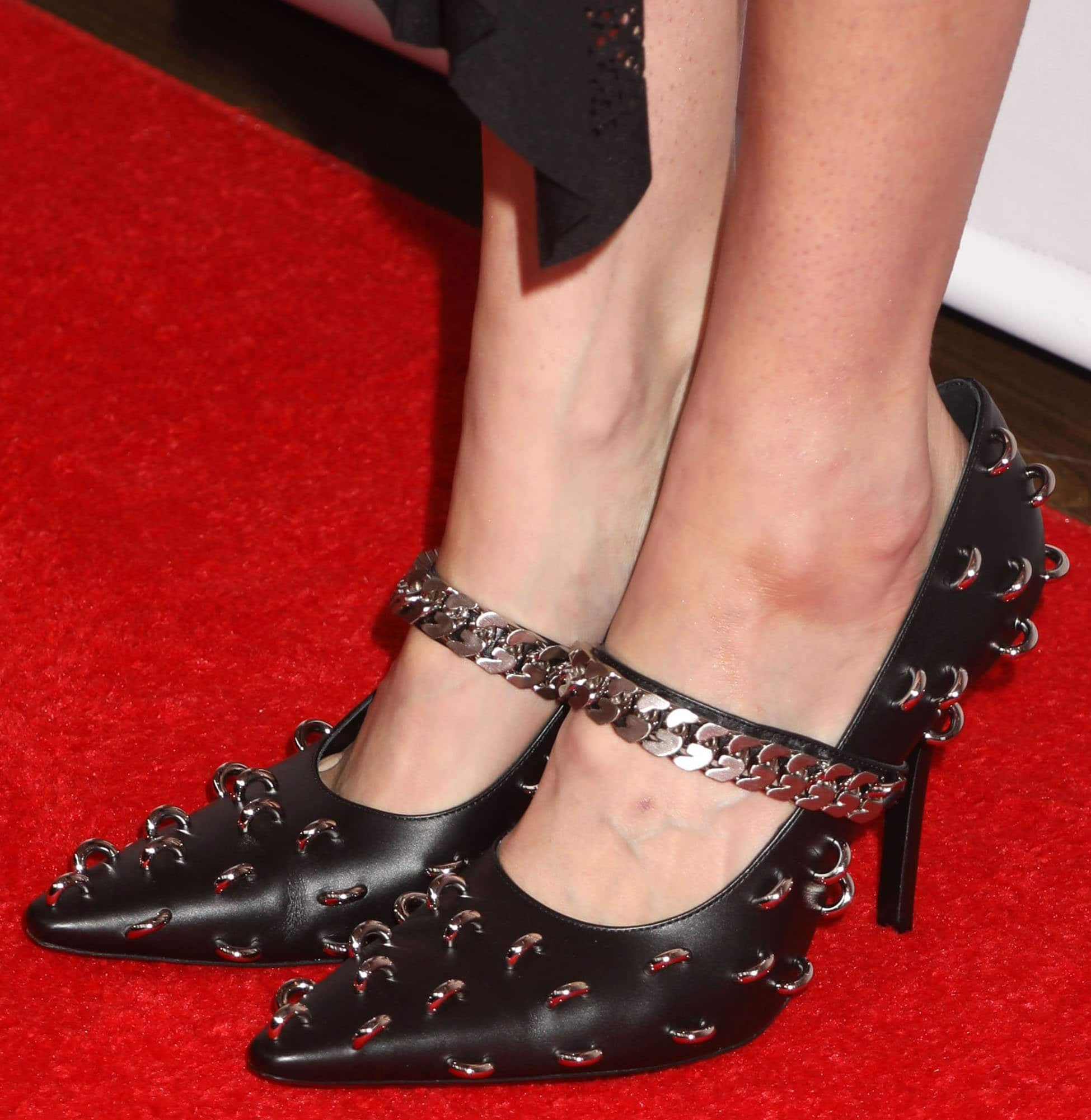 Gigi Hadid completes an edgy yet sexy look by showing off her feet in Givenchy metal hoop-embellished pumps
