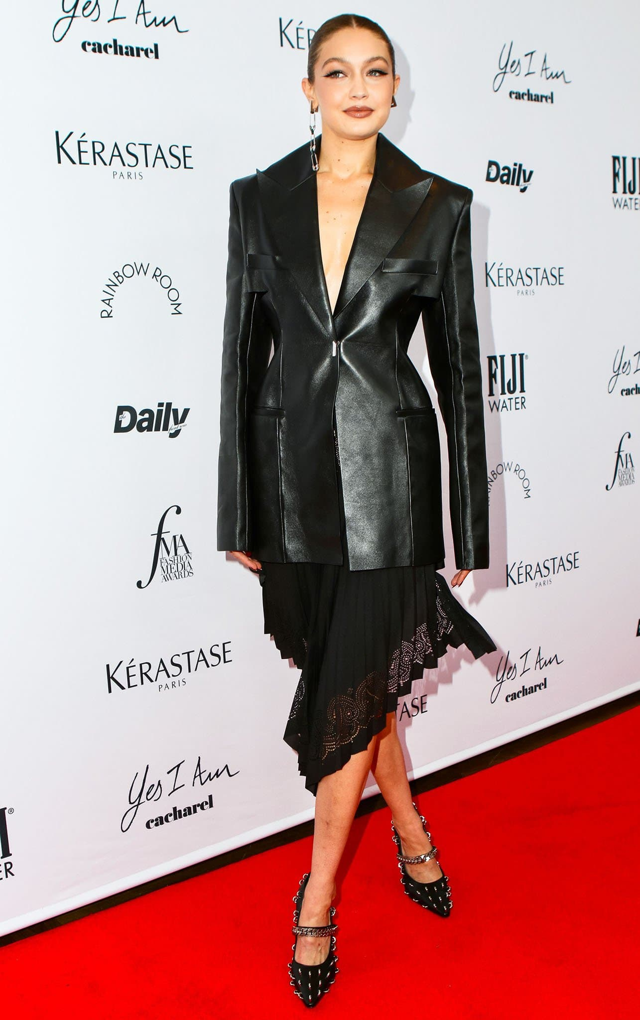Gigi Hadid goes braless underneath her Givenchy leather jacket and asymmetrical skirt at The Daily Front Row Fashion Media Awards