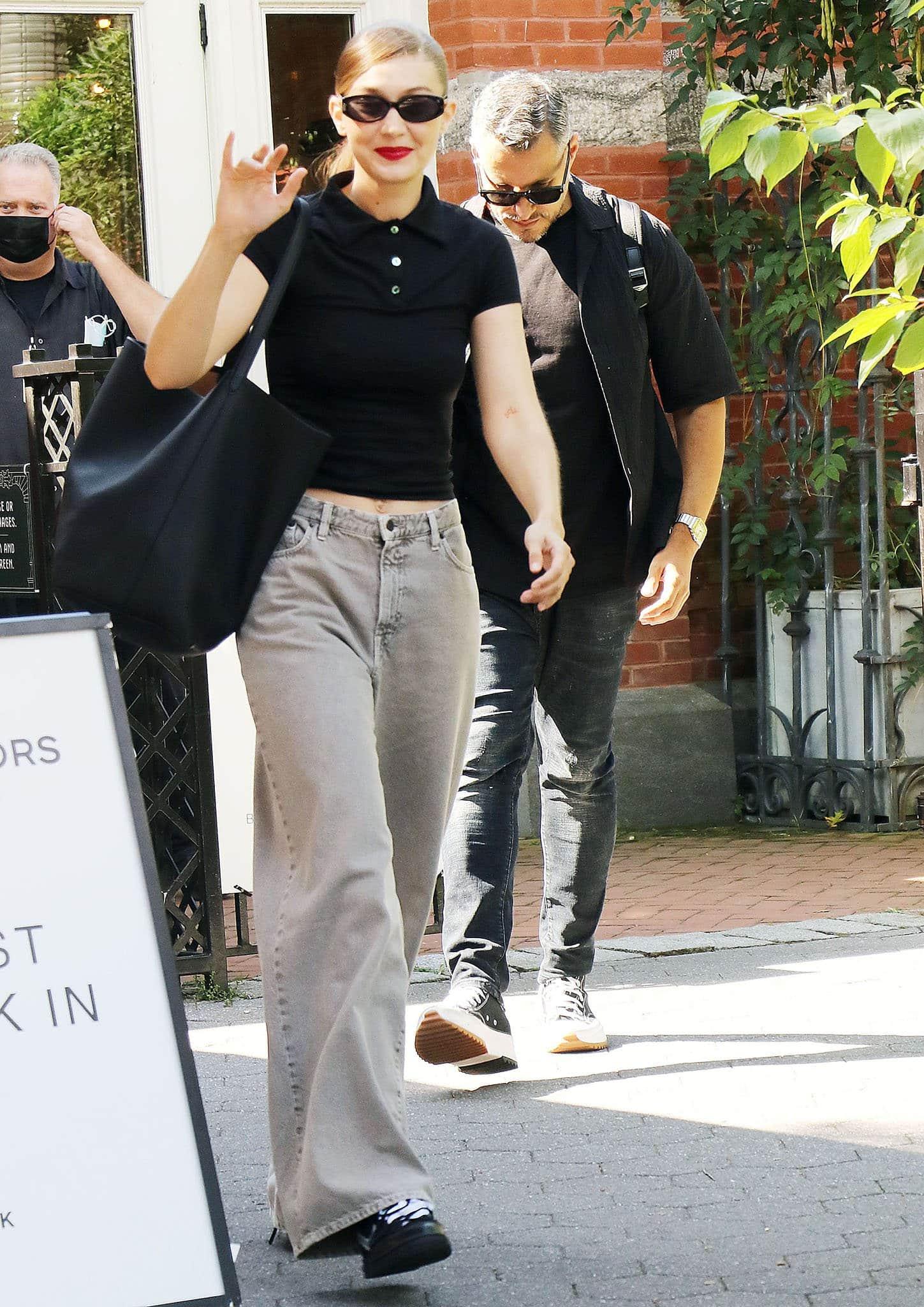 Gigi Hadid teams a casual Bleu Salt polo shirt with The Row jeans outside Michael Kors' NYFW show at Tavern On The Green on September 10, 2021