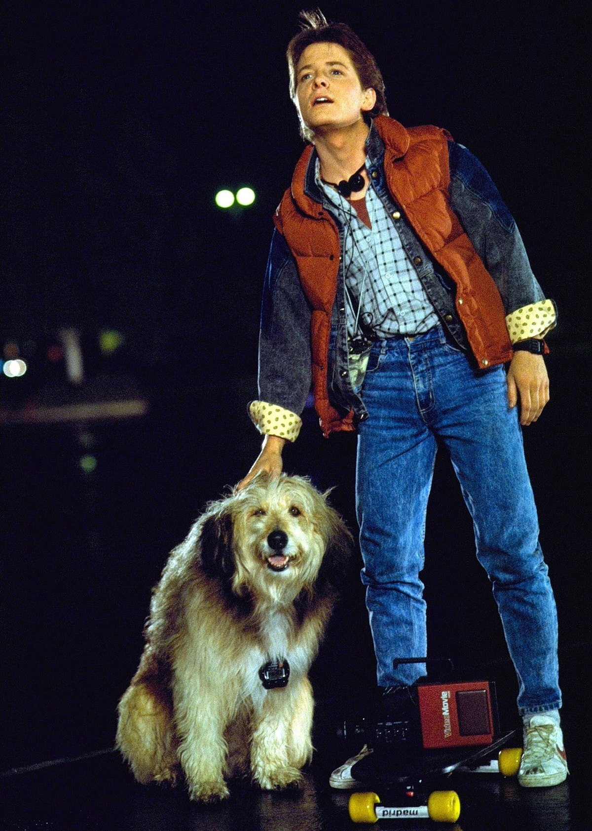 Michael J. Fox as Marty McFly wears blue Guess jeans with white Nike Bruin shoes and a down vest for the 1985 American science fiction film Back to the Future