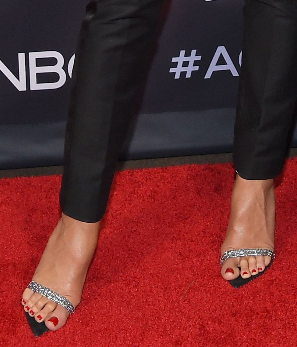 Heidi Klum pairs her sparkling outfit with red pedicure and crystal-embellished pointy sandals