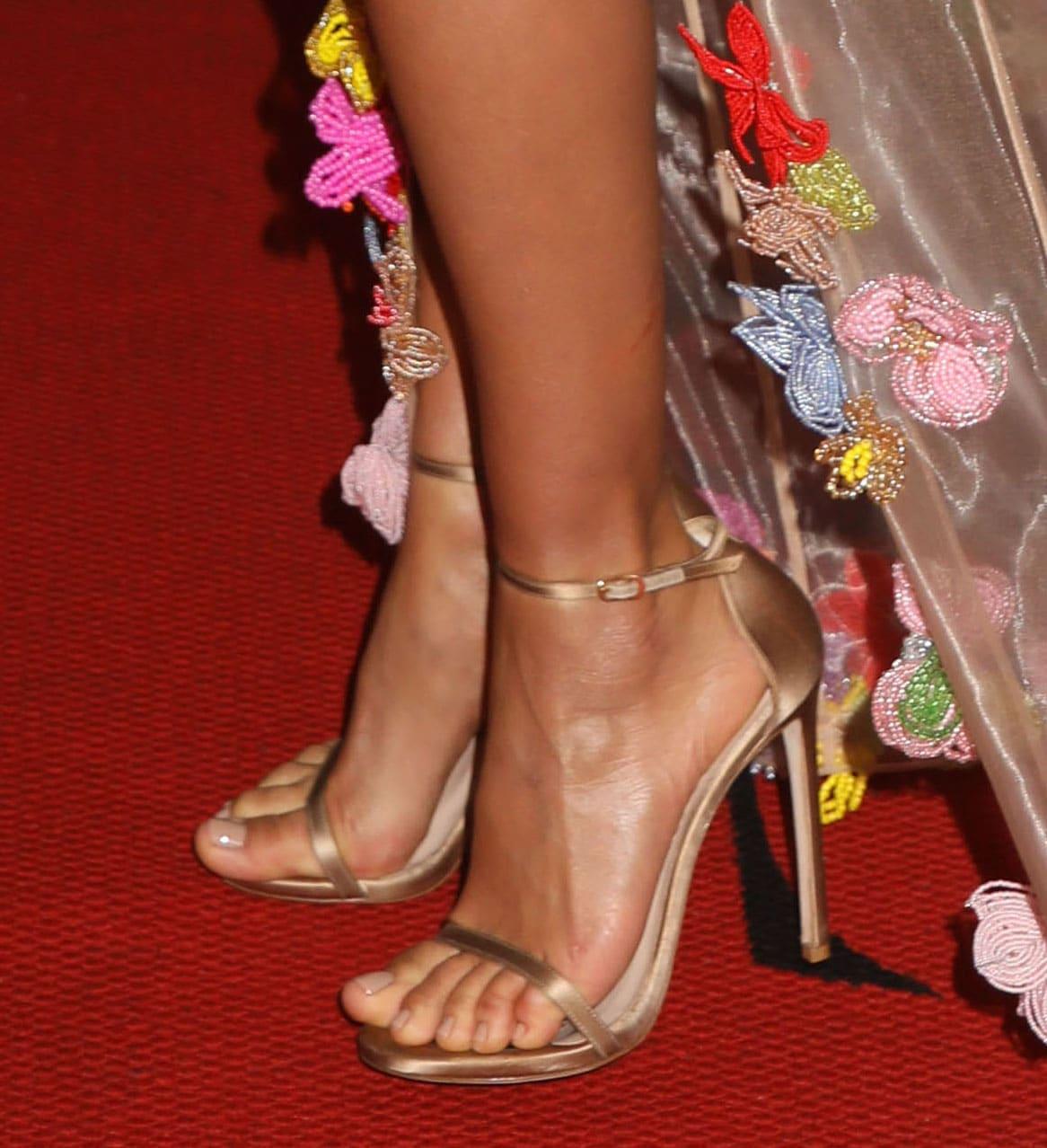 Irina Shayk displays her feet in classic Stuart Weitzman Nudist heels