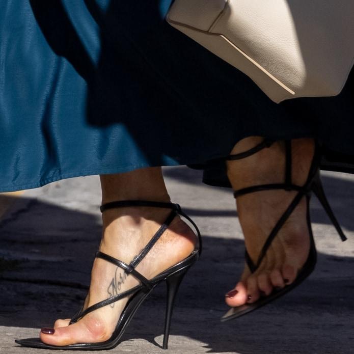 Jennifer Aniston shows off her foot tattoo in black Saint Laurent Instinct 110 heeled sandals