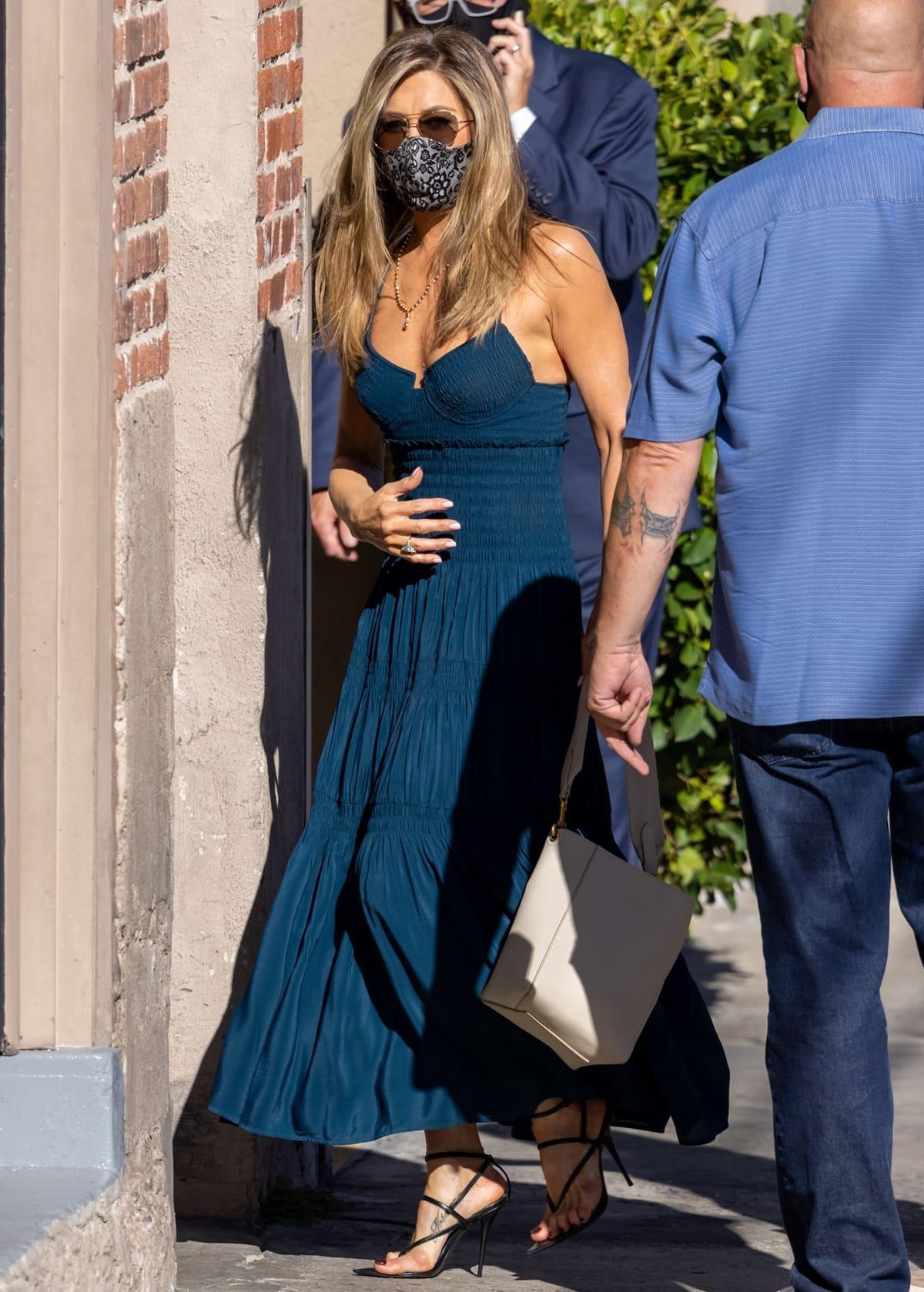 Jennifer Aniston in a Proenza Schouler smocked bustier dress and Saint Laurent Instinct sandals