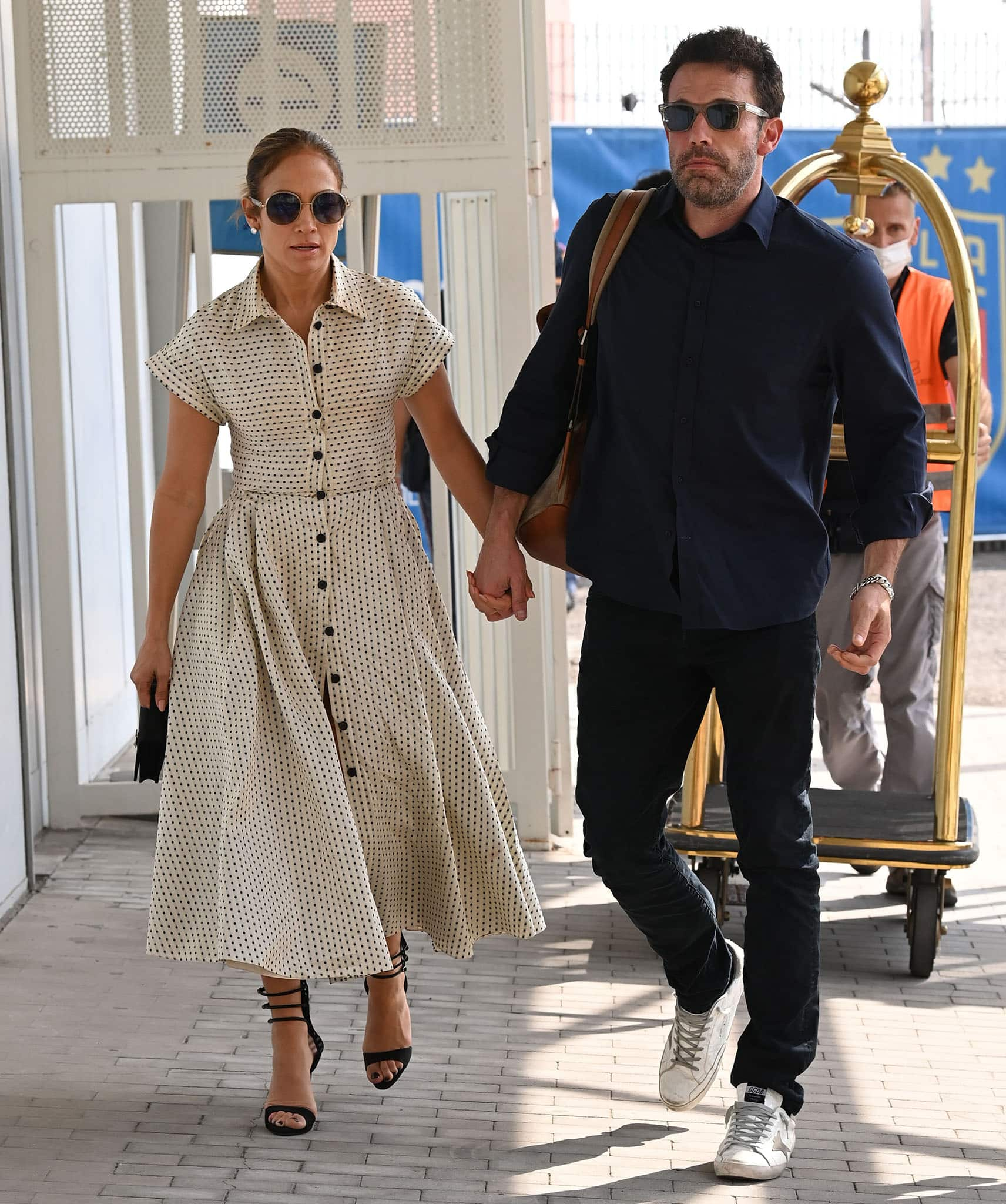 Jennifer Lopez and Ben Affleck holding hands at the Venice Marco Polo Airport on September 11, 2021