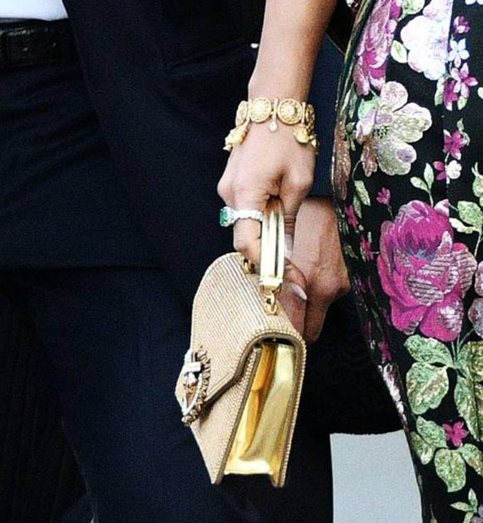 Jennifer Lopez carries a gold crystal-embellished Dolce & Gabbana mini Devotion bag