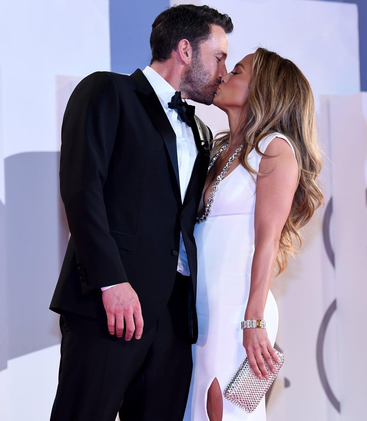 Jennifer Lopez kisses her boyfriend Ben Affleck during the 2021 Venice Film Festival
