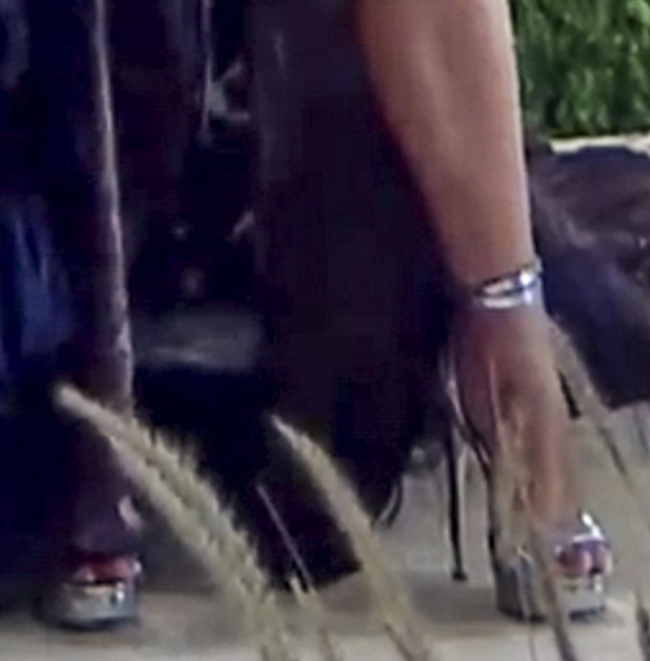 Jennifer Lopez pairs her Western-inspired gown with metallic silver high heels from her collection for DSW