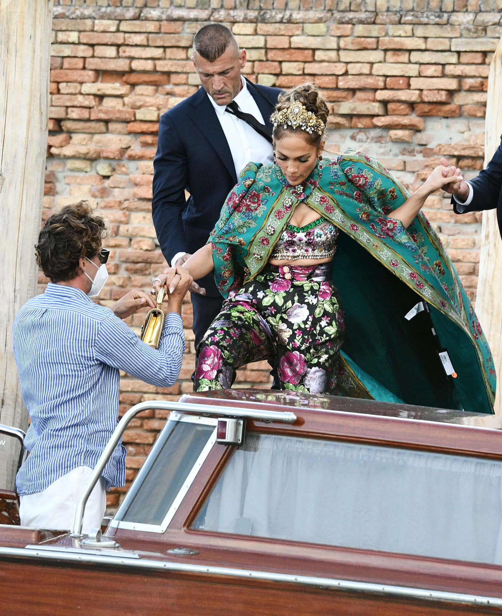 Jennifer Lopez accidentally leaves the price tag on her Dolce & Gabbana pelisse cape