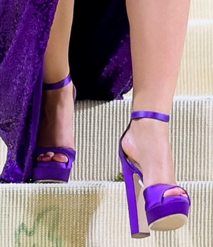 Camila Cabello completes her monochrome outfit with Jimmy Choo Liberty sandals in purple