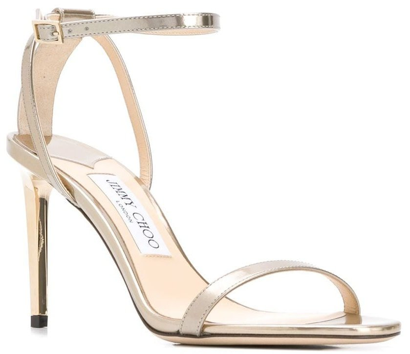 The Jimmy Choo Minny features a classic silhouette with an ankle strap, toe strap, and a stiletto heel