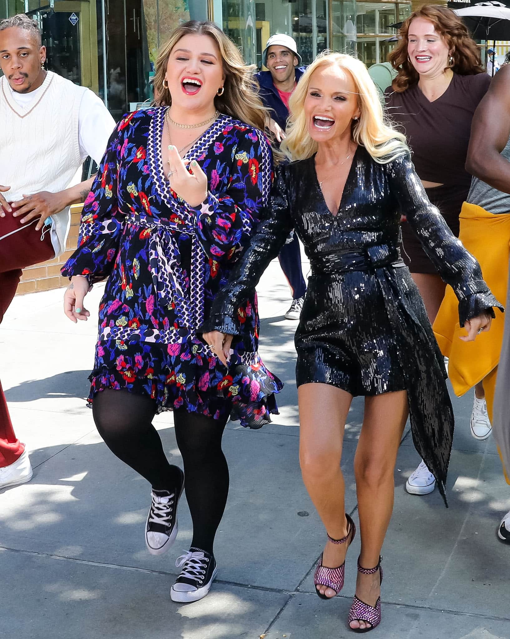 Kelly Clarkson and Kristin Chenoweth filming a music video for the season premiere of The Kelly Clarkson Show on August 24, 2021