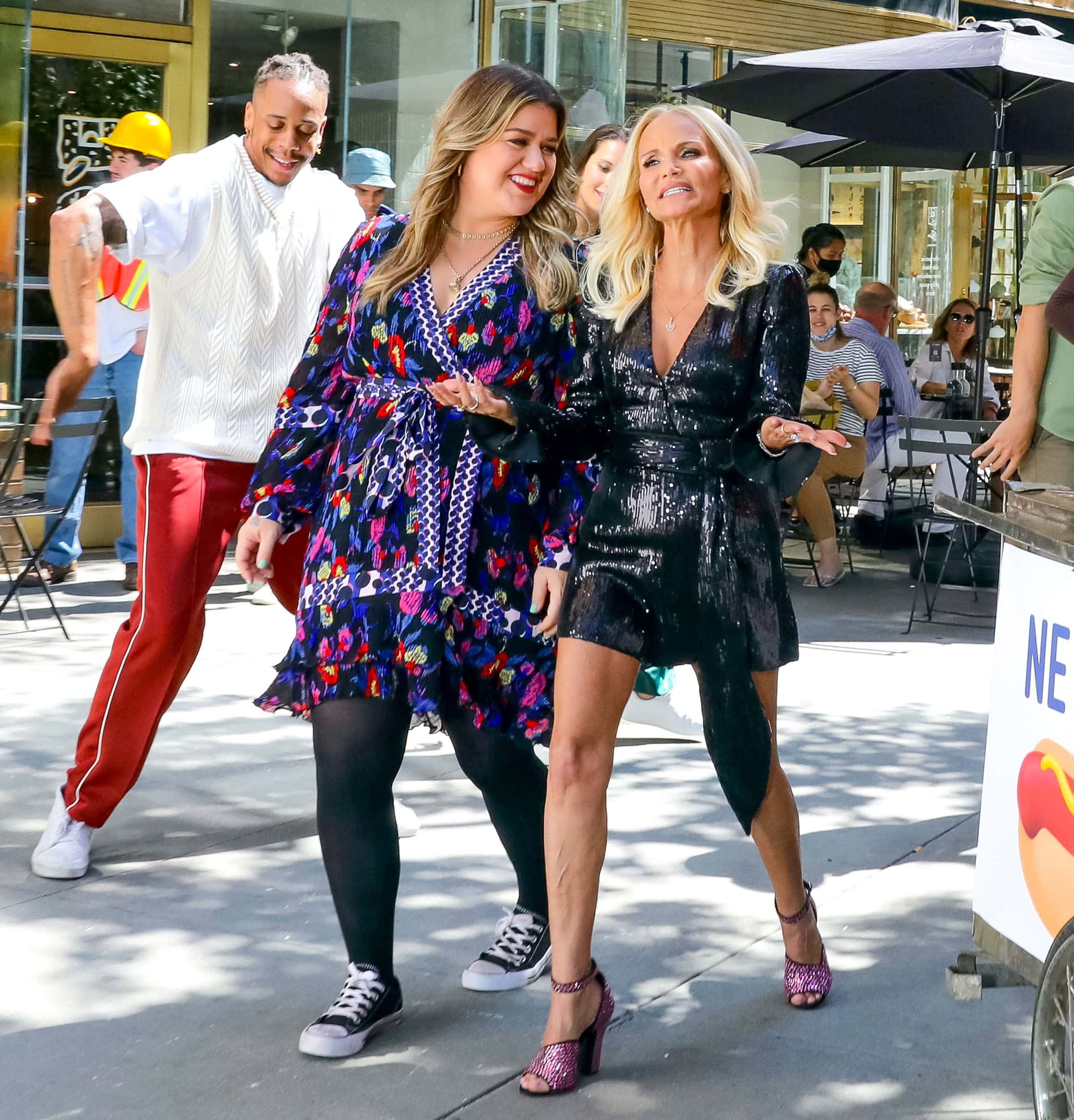 Kelly Clarkson and Kristin Chenoweth are all smiles while in the Columbus Circle subway station in New York City